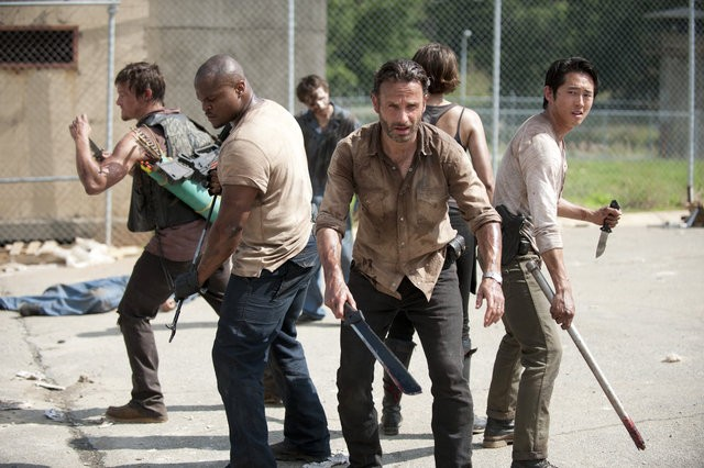 Norman Reedus, IronE Singleton, Andrew Lincoln, Lauren Cohan, and Steven Yeun in 'The Walking Dead'