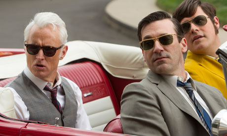 Roger Sterling (John Slattery), Don Draper (Jon Hamm) and Harry Crane (Rich Sommer) check things out